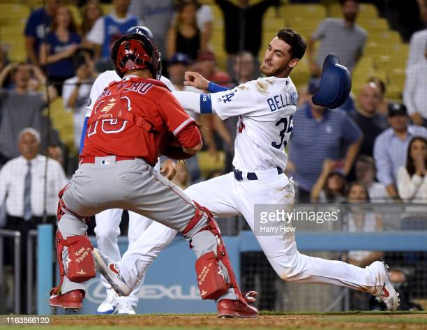 Cody Bellinger of the Los Angeles Dodgers is tagged out at home by Dustin Garneau of the Los Angeles Angels to end the game for a 54 Angel win during...