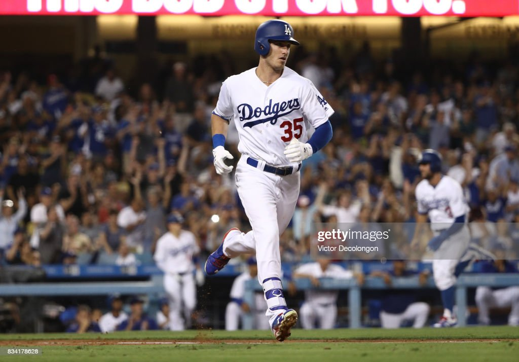 Cody Bellinger #35 of the Los Angeles Dodgers jogs to first base on his rbi single to right field during the third inning of the MLB game against the San Diego Padres at Dodger Stadium on August 11, 2017 in Los Angeles, California. The Padres defeated the Dodgers 4-3.