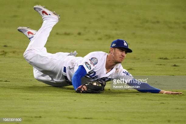 Cody Bellinger of the Los Angeles Dodgers makes a catch during the tenth inning against the Milwaukee Brewers in Game Four of the National League...