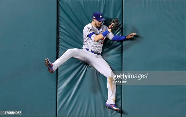 Cody Bellinger of the Los Angeles Dodgers makes the catch on a sacrifice fly hit by Anthony Rendon of the Washington Nationals to drive in a run in...