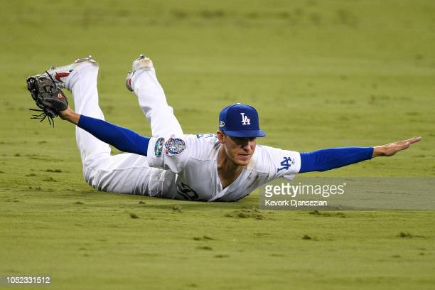 Cody Bellinger of the Los Angeles Dodgers reacts after making a catch during the tenth inning against the Milwaukee Brewers in Game Four of the...