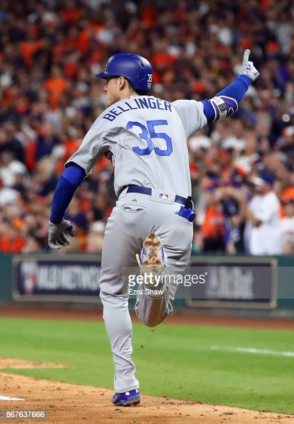Cody Bellinger of the Los Angeles Dodgers reacts as he hits a RBI double during the ninth inning against the Houston Astros in game four of the 2017...