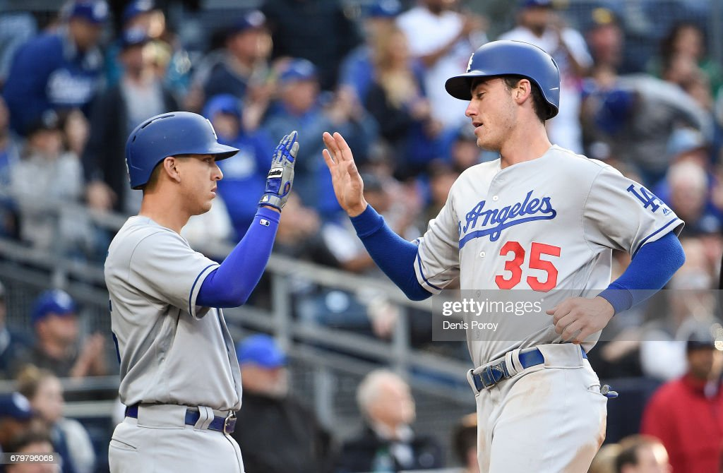 Cody Bellinger #35 of the Los Angeles Dodgers, right, is congratulated by Austin Barnes #15 after scoring during the fourth inning of a baseball game against the San Diego Padres at PETCO Park on May 6, 2017 in San Diego, California.