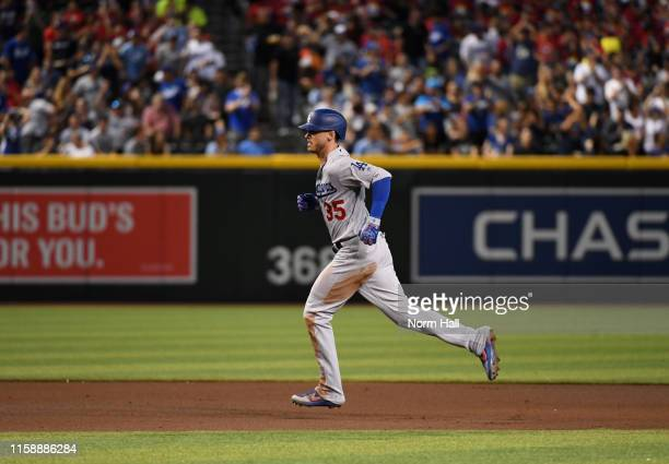 Cody Bellinger of the Los Angeles Dodgers rounds the bases after hitting a solo home run off of Taylor Clarke of the Arizona Diamondbacks during the...