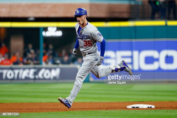 Cody Bellinger of the Los Angeles Dodgers rounds the bases after hitting a threerun home run during the fifth inning against the Houston Astros in...