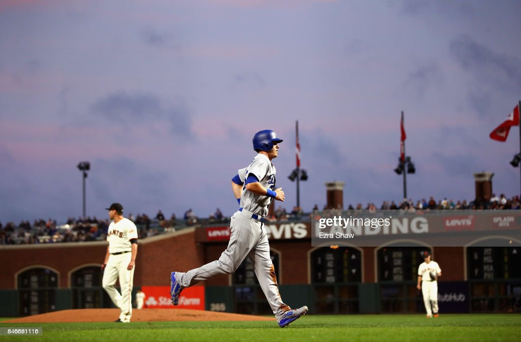 Cody Bellinger #35 of the Los Angeles Dodgers runs home to score on a double hit by Logan Forsythe #11 in the first inning against the San Francisco Giants at AT&T Park on September 13, 2017 in San Francisco, California.