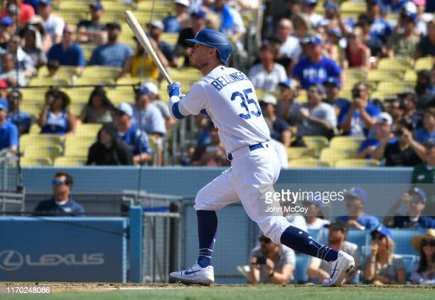 Cody Bellinger of the Los Angeles Dodgers runs to first after he hit a grand slam home run against the Colorado Rockies in the fifth inning at Dodger...