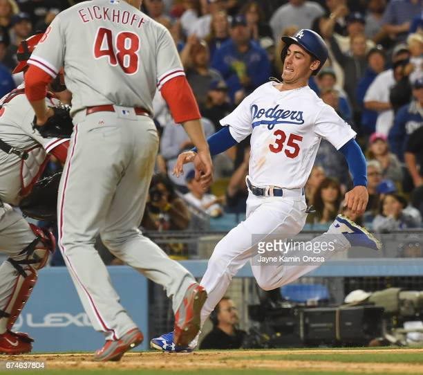 Cody Bellinger of the Los Angeles Dodgers scores past Jerad Eickhoff of the Philadelphia Phillies on a double by Enrique Hernandez of the Los Angeles...