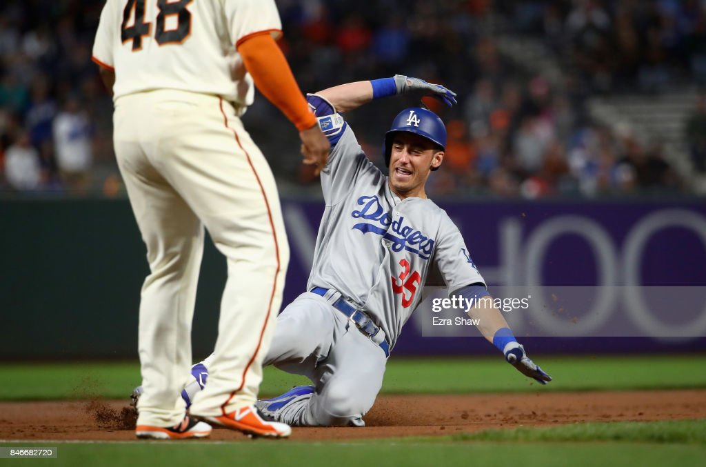 Cody Bellinger #35 of the Los Angeles Dodgers slides in for a triple in the first inning against the San Francisco Giants at AT&T Park on September 13, 2017 in San Francisco, California.