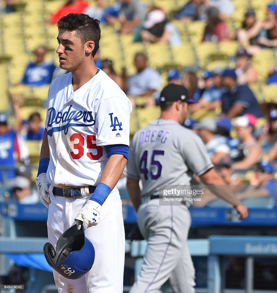 Cody Bellinger #35 of the Los Angeles Dodgers stands on the field after he was struck out by pitcher Scott Oberg #45 of the Colorado Rockies in the eighth inning of the game at Dodger Stadium on September 10, 2017 in Los Angeles, California.