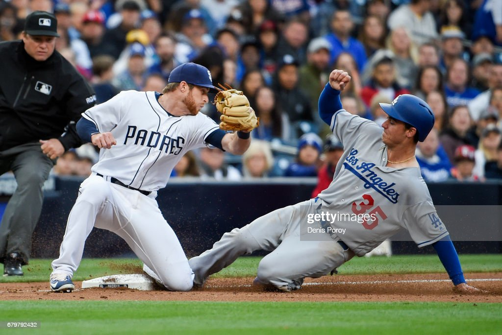 Cody Bellinger #35 of the Los Angeles Dodgers steals third base ahead of the tag of Cory Spangenberg #15 of the San Diego Padres during the fourth inning of a baseball game at PETCO Park on May 6, 2017 in San Diego, California.