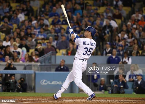 Cody Bellinger of the Los Angeles Dodgers watches the ball leave the ball park for his threerun home run his 39th of the season to break the National...