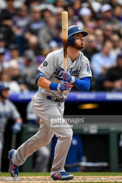 Cody Bellinger of the Los Angeles Dodgers watches the flight of a fifth inning threerun homer against the Colorado Rockies during the Colorado...