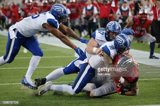 Cody Brown of the Houston Roughnecks tackled at the 1 yard line by Jordan Ta'amu of the St Louis Battlehawks after an interception at TDECU Stadium...