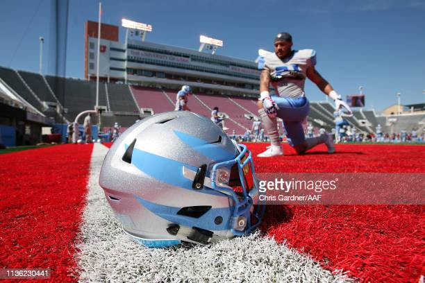 Cody Brown of the Salt Lake Stallions stretches as a helmet is seen in the foreground before the game against the Memphis Express at Rice Eccles...