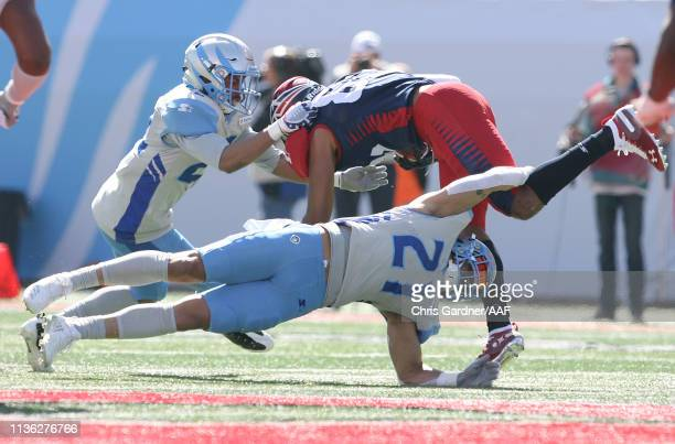 Cody Brown of the Salt Lake Stallions tackles a player on the Memphis Express at Rice Eccles Stadium on March 16 2019 in Salt Lake City Utah