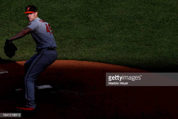 Cody Carroll of the Baltimore Orioles pitches against the Boston Red Sox during the seventh inning at Fenway Park on September 26 2018 in Boston...