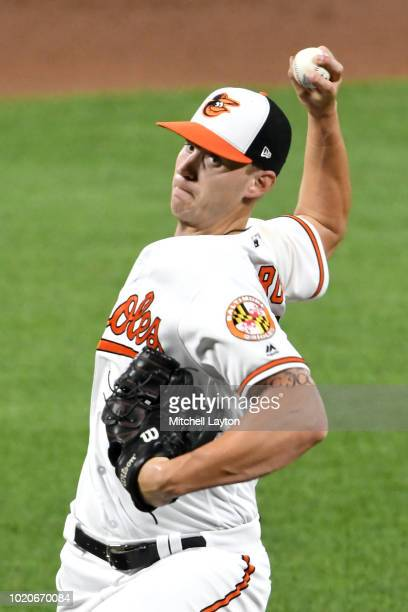 Cody Carroll of the Baltimore Orioles pitches during a baseball game the New York Mets at Oriole Park at Camden Yards on August 15 2018 in Baltimore...