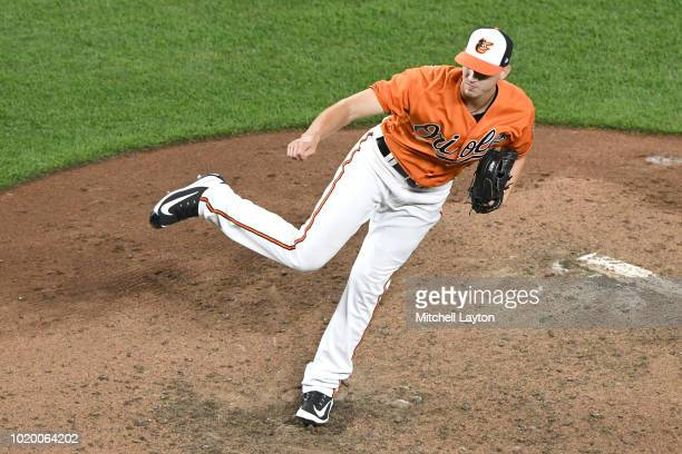 Cody Carroll of the Baltimore Orioles pitches during game two of a doubleheader against the Boston Red Sox at Oriole Park at Camden Yards on August...