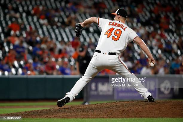 Cody Carroll of the Baltimore Orioles pitches in the eighth inning against the New York Mets at Oriole Park at Camden Yards on August 15 2018 in...