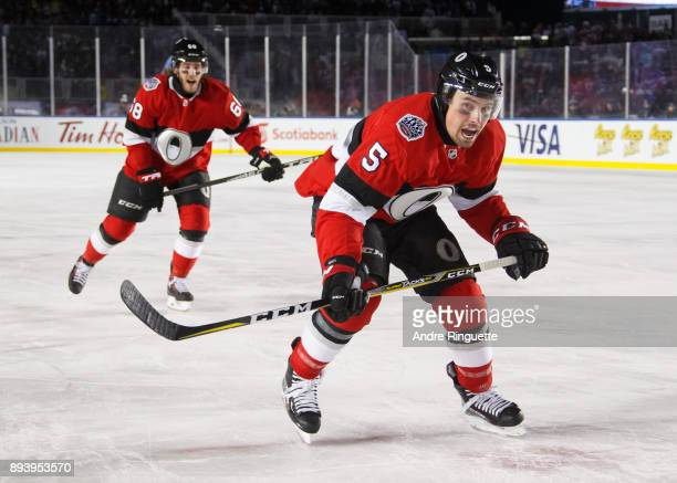 Cody Ceci and Mike Hoffman of the Ottawa Senators skate against the Montreal Canadiens during the second period of the 2017 Scotiabank NHL100 Classic...