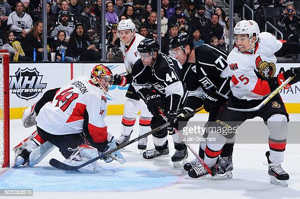 Cody Ceci Mark Borowiecki and Craig Anderson of the Ottawa Senators battle in front of the net against Jeff Carter and Vincent Lecavalier of the Los...