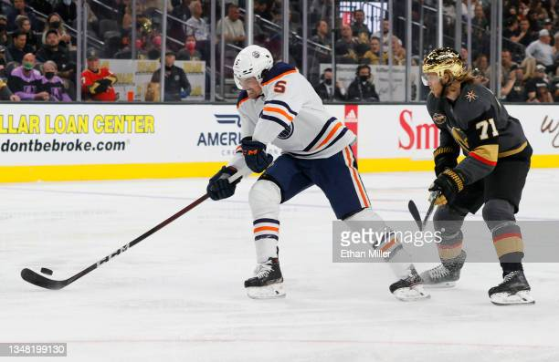 Cody Ceci of the Edmonton Oilers controls the puck against William Karlsson of the Vegas Golden Knights in the second period of their game at...
