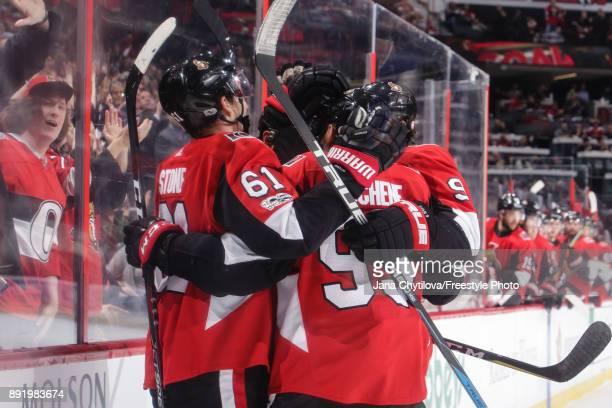 Cody Ceci of the Ottawa Senators celebrates his second period goal against the New York Rangers with teammates Mark Stone Matt Duchene and Bobby Ryan...