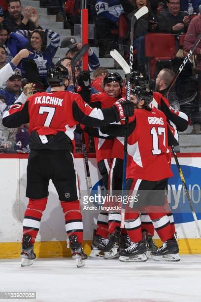 Cody Ceci of the Ottawa Senators celebrates his third period goal against the Toronto Maple Leafs with teammates Brady Tkachuk and Brian Gibbons at...