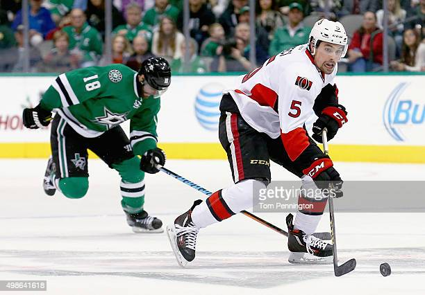 Cody Ceci of the Ottawa Senators controls the puck against Patrick Eaves of the Dallas Stars in the second period at American Airlines Center on...