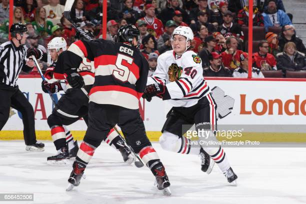 Cody Ceci of the Ottawa Senators defends against John Hayden of the Chicago Blackhawks at Canadian Tire Centre on March 16 2017 in Ottawa Ontario...