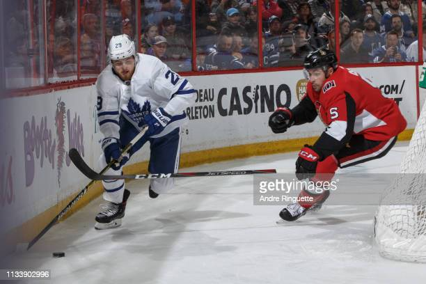 Cody Ceci of the Ottawa Senators defends against William Nylander of the Toronto Maple Leafs behind the net at Canadian Tire Centre on March 30 2019...