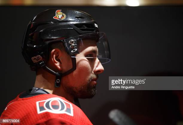 Cody Ceci of the Ottawa Senators looks on in the players' tunnel prior to a game against the Montreal Canadiens at Canadian Tire Centre on October 30...