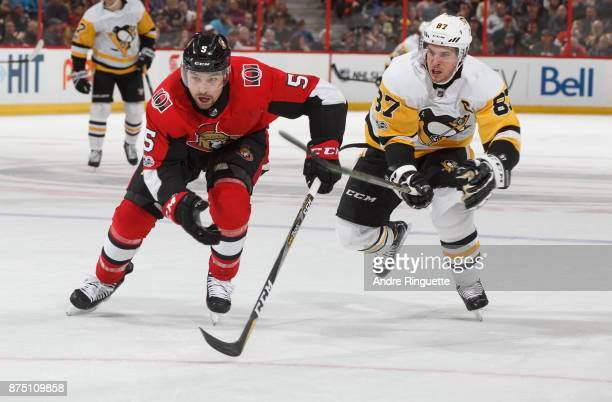Cody Ceci of the Ottawa Senators races to beat an icing call against Sidney Crosby of the Pittsburgh Penguins at Canadian Tire Centre on November 16...