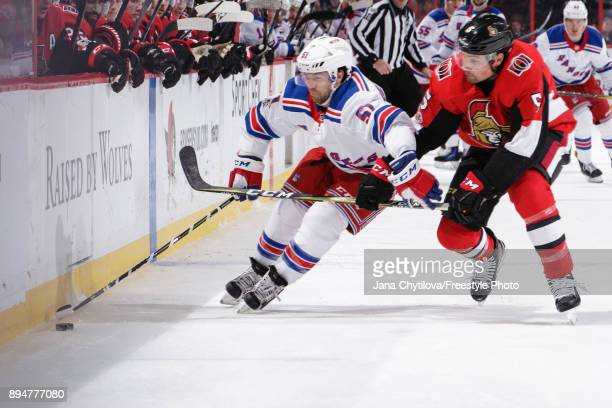 Cody Ceci of the Ottawa Senators uses his stick to slow down a puck carrying David Desharnais of the New York Rangers at Canadian Tire Centre on...