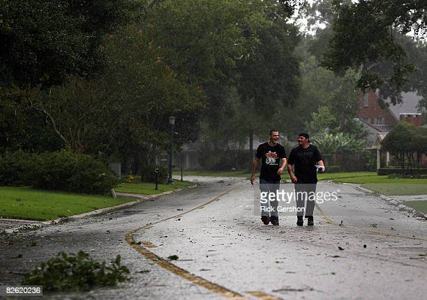 Cody Champagne and Michael Goff laugh as they walk down Bayou Parkway, as the effects of Hurricane Gustav were just beginning to be felt with...