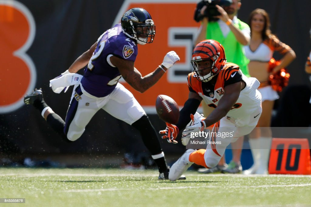 Cody Core #16 of the Cincinnati Bengals catches a pass from Andy Dalton #14 of the Cincinnati Bengals during the fourth quarter of the game against the Baltimore Ravens at Paul Brown Stadium on September 10, 2017 in Cincinnati, Ohio.