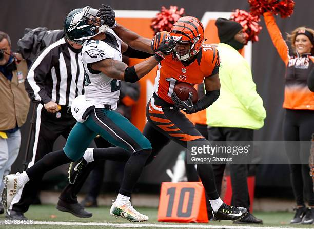 Cody Core of the Cincinnati Bengals stiff-arms Rodney McLeod of the Philadelphia Eagles during the first quarter at Paul Brown Stadium on December 4,...