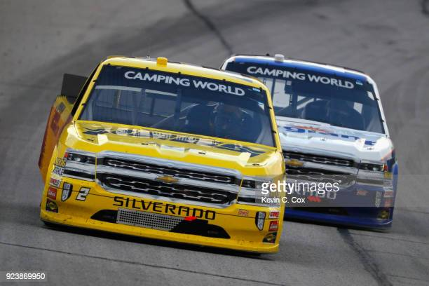 Cody Coughlin driver of the JEGScom Chevrolet leads Johnny Sauter driver of the Allegiant Airlines Chevrolet during the NASCAR Camping World Truck...
