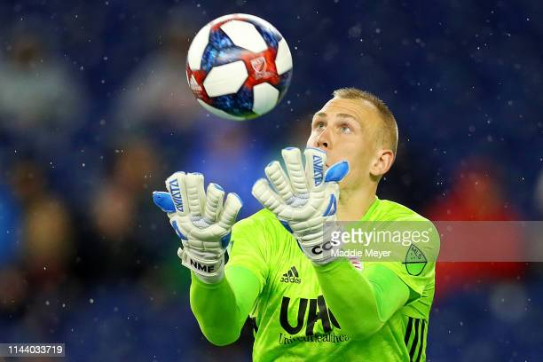 Cody Cropper of New England Revolution makes a save during the first half of the game against the New York Red Bulls at Gillette Stadium on April 20...