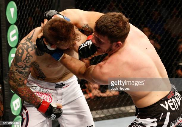 Cody Donovan lands a left against Nikita Krylov in their light heavyweight bout during the UFC Fight Night event at The O2 Dublin on July 19 2014 in...