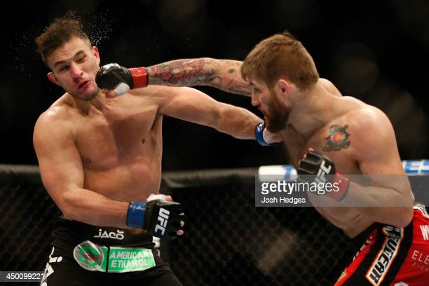 Cody Donovan punches Gian Villante in their light heavyweight bout during the UFC 167 event inside the MGM Grand Garden Arena on November 16 2013 in...