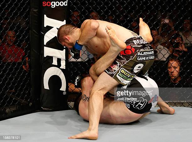 Cody Donovan punches Nick Penner during their light heavyweight fight at the UFC on FX event on December 15 2012 at Gold Coast Convention and...