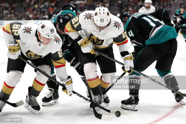Cody Eakin and Nate Schmidt of the Vegas Golden Knights compete for the puck against Daniel Sprong and Adam Henrique of the Anaheim Ducks during the...