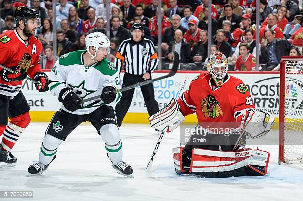 Cody Eakin of the Dallas Stars and Brent Seabrook of the Chicago Blackhawks watch the puck fly past goalie Michael Leighton in the second period of...