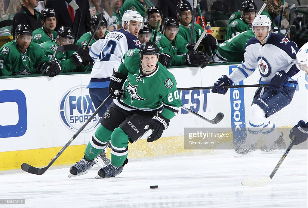 Cody Eakin #20 of the Dallas Stars handles the puck against the Winnipeg Jets at the American Airlines Center on March 24, 2014 in Dallas, Texas.