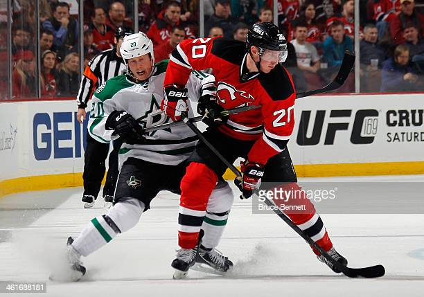Cody Eakin of the Dallas Stars holds back Ryan Carter of the New Jersey Devils at the Prudential Center on January 9 2014 in Newark New Jersey The...