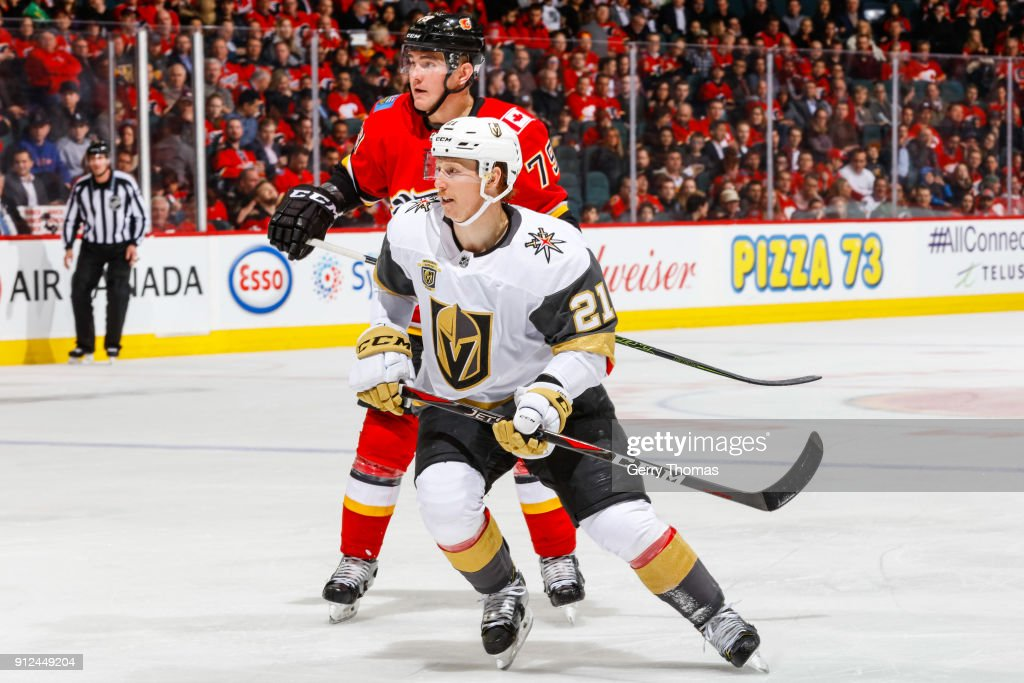 Cody Eakin #21 of the Vegas Golden Knights and Micheal Ferland #79 of the Calgary Flames in an NHL game on January 30, 2018 at the Scotiabank Saddledome in Calgary, Alberta, Canada.