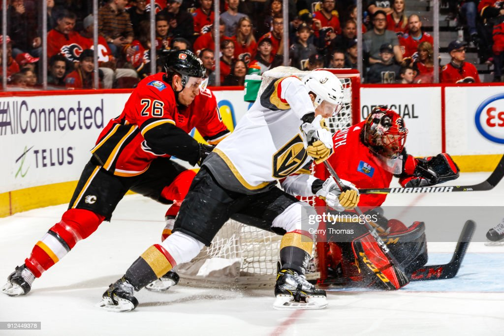 Cody Eakin #21 of the Vegas Golden Knights attacks Goalie Mike Smith #41 of the Calgary Flames in an NHL game on January 30, 2018 at the Scotiabank Saddledome in Calgary, Alberta, Canada.