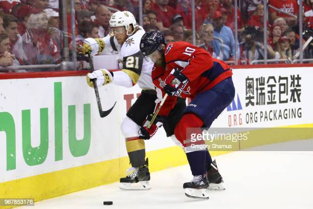 Cody Eakin of the Vegas Golden Knights battles for the puck with Brett Connolly of the Washington Capitals during the first period in Game Four of...